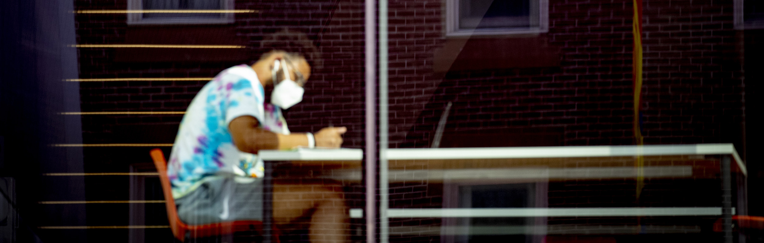 student on campus with mask